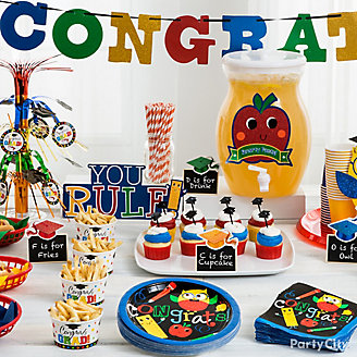 Graduation Table Ideas graduation year candy cups idea Get Inspired Kids Graduation Party Table Idea