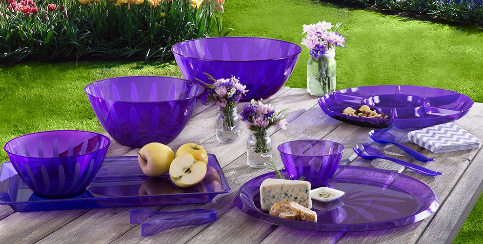 purple serving trays, bowls and utensils