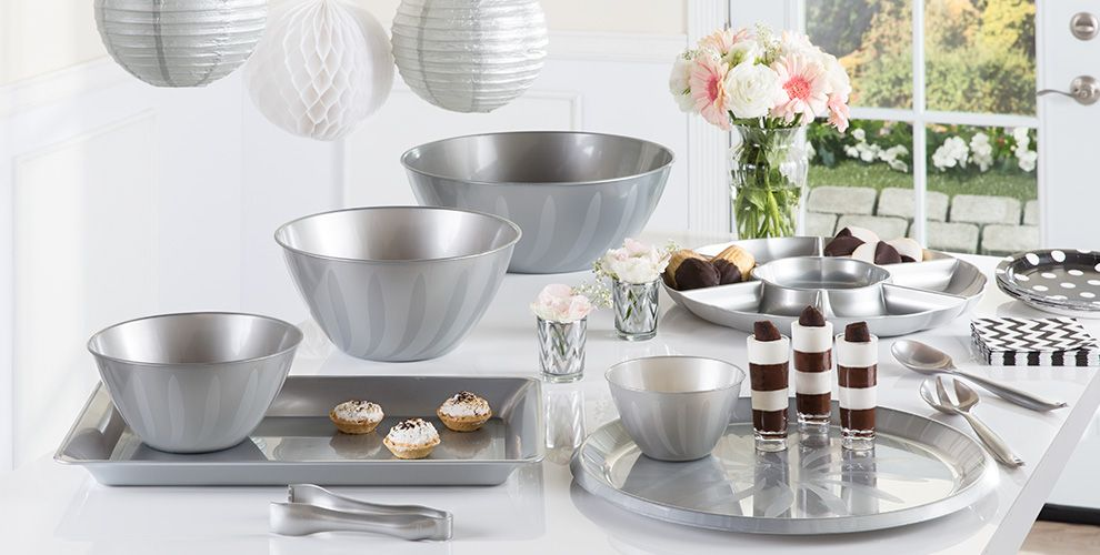 silver serving trays, bowls and utensils