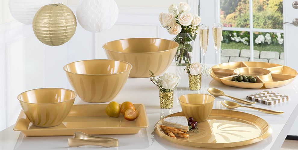 gold serving trays, bowls and utensils
