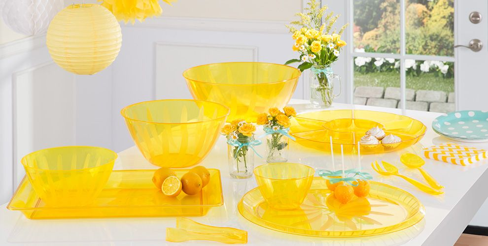 yellow serving trays, bowls and utensils